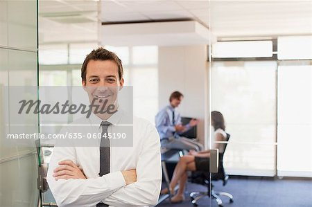 Portrait of smiling businessman in office Stock Photo - Premium Royalty-Free, Image code: 635-06045190