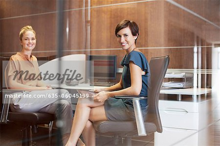 Portrait of smiling businesswomen in office Stock Photo - Premium Royalty-Free, Image code: 635-06045199