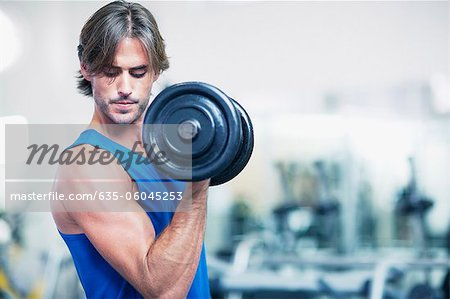 Man holding dumbbell Stock Photo - Premium Royalty-Free, Image code: 635-06045253