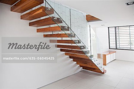 Wooden stairs in modern house Stock Photo Masterfile Premium
