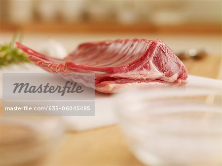 Raw rack of lamb on cutting board Stock Photo - Premium Royalty-Free, Image code: 635-06045485