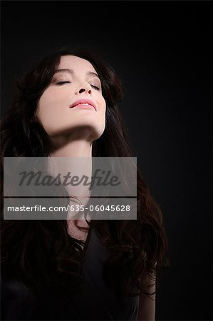 Portrait of sensual woman with head back Stock Photo - Premium Royalty-Free, Image code: 635-06045628