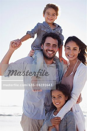 Portrait of smiling family on beach Stock Photo - Premium Royalty-Free, Image code: 635-06191643