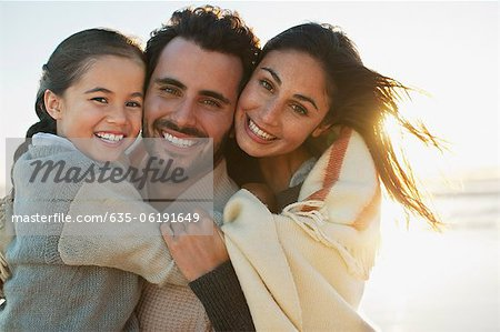 Portrait of smiling family on sunny beach Stock Photo - Premium Royalty-Free, Image code: 635-06191649