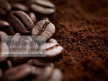 Close up of whole coffee beans and ground coffee Stock Photo - Premium Royalty-Free, Image code: 635-06191755