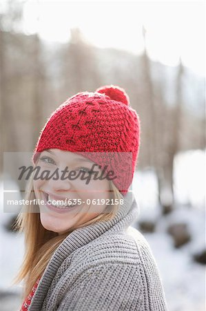 Close up portrait of smiling woman with red knit hat Stock Photo - Premium Royalty-Free, Image code: 635-06192158