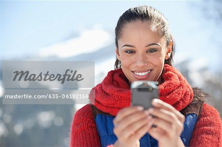 Smiling woman checking cell phone
