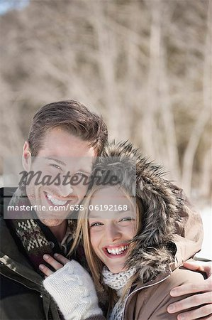 Portrait of smiling couple hugging outdoors Stock Photo - Premium Royalty-Free, Image code: 635-06192168