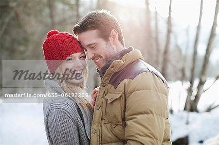 Portrait of smiling couple in snowy woods Stock Photo - Premium Royalty-Free, Image code: 635-06192209