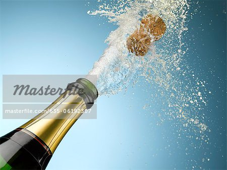 Champagne and cork exploding from bottle Stock Photo - Premium Royalty-Free, Image code: 635-06192307