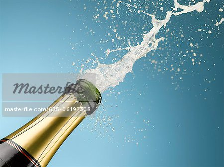 Champagne exploding from bottle Stock Photo - Premium Royalty-Free, Image code: 635-06192308
