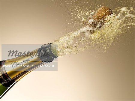 Champagne and cork exploding from bottle Stock Photo - Premium Royalty-Free, Image code: 635-06192310