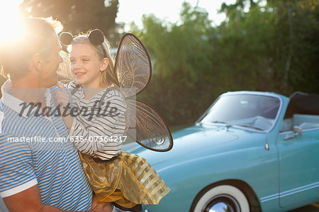 Father holding daughter in fairy wings Stock Photo - Premium Royalty-Free, Image code: 635-07364217