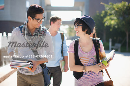 Students walking together outdoors Stock Photo - Premium Royalty-Free, Image code: 635-07364601