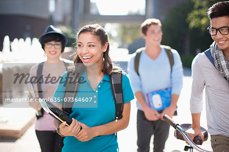 Students walking together outdoors Stock Photo - Premium Royalty-Free, Image code: 635-07364607