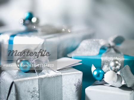 Christmas gifts with silver ribbon Stock Photo - Premium Royalty-Free, Image code: 635-07364823