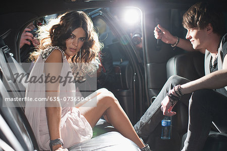 Celebrities emerging from car towards paparazzi Stock Photo - Premium Royalty-Free, Image code: 635-07365045