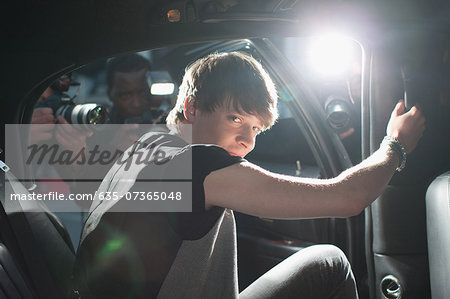 Man exiting limo Stock Photo - Premium Royalty-Free, Image code: 635-07365048