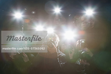Paparazzi taking pictures with flash Stock Photo - Premium Royalty-Free, Image code: 635-07365062