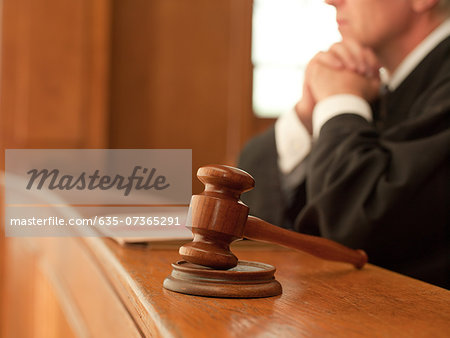Judge and gavel in courtroom Stock Photo - Premium Royalty-Free, Image code: 635-07365291
