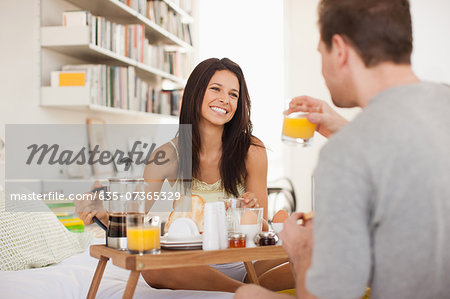 Couple eating breakfast in bed Stock Photo - Premium Royalty-Free, Image code: 635-07365329