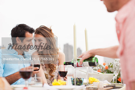 Couples enjoying party on balcony Stock Photo - Premium Royalty-Free, Image code: 635-07365361