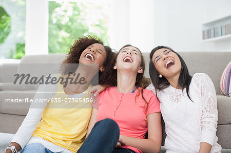 Smiling teenage girls Stock Photo - Premium Royalty-Free, Image code: 635-07365456