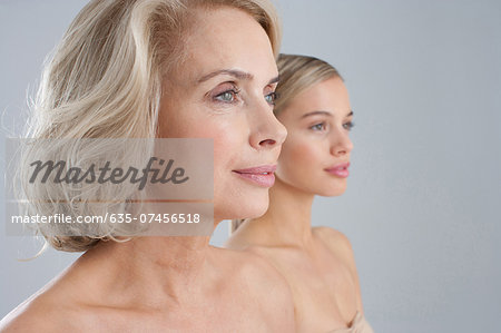 Close up of bare chested mother and daughter Stock Photo - Premium Royalty-Free, Image code: 635-07456518