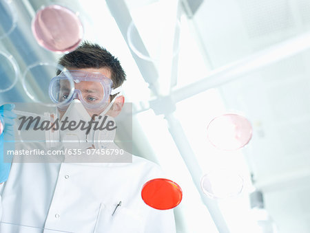 Scientist examining items in lab Stock Photo - Premium Royalty-Free, Image code: 635-07456790