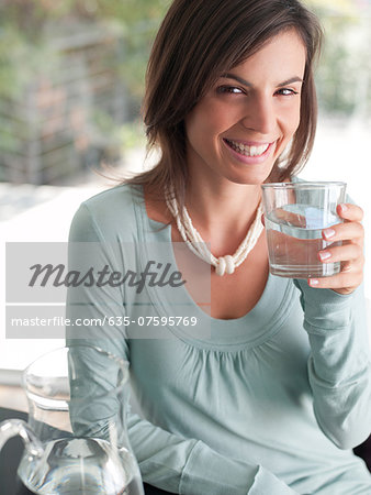 Woman drinking water Stock Photo - Premium Royalty-Free, Image code: 635-07595769