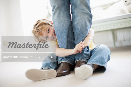 Son hugging grandfather's legs Stock Photo - Premium Royalty-Free, Image code: 635-07595954