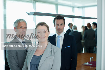 Portrait of smiling business people in conference room Stock Photo - Premium Royalty-Free, Image code: 635-07670765