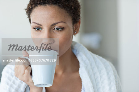 Woman taking Coffee Stock Photo - Premium Royalty-Free, Image code: 635-07670829