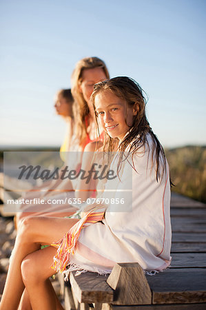 Family sitting on pier near beach Stock Photo - Premium Royalty-Free, Image code: 635-07670856