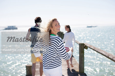 Friends on pier Stock Photo - Premium Royalty-Free, Image code: 635-07670941