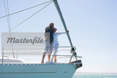Mature couple hugging on deck of sailboat Stock Photo - Premium Royalty-Free, Image code: 635-07762894