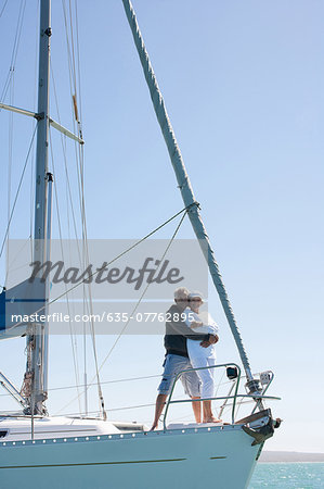 Mature couple hugging on deck of sailboat Stock Photo - Premium Royalty-Free, Image code: 635-07762895