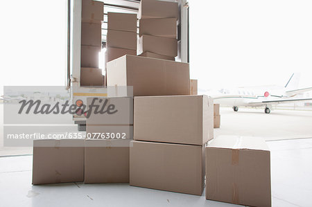 Boxes waiting to be loaded onto truck Stock Photo - Premium Royalty-Free, Image code: 635-07763002