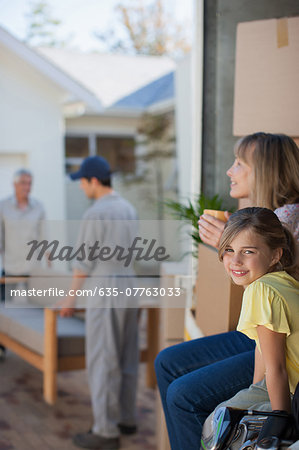 Family moving into new home Stock Photo - Premium Royalty-Free, Image code: 635-07763033
