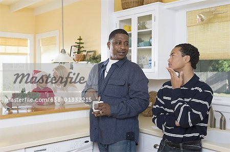 An inter-racial family in the kitchen Stock Photo - Premium Royalty-Free, Image code: 638-01332215