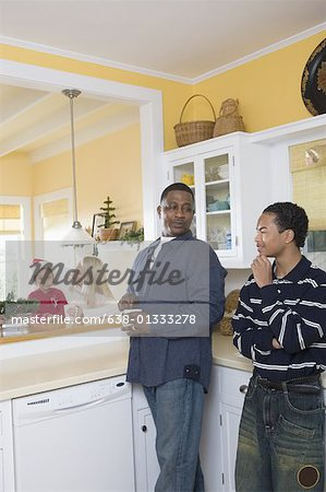 An inter-racial family in the kitchen Stock Photo - Premium Royalty-Free, Image code: 638-01333278