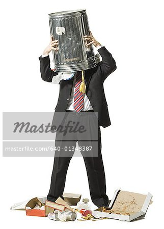 Businessman with trash can on head Stock Photo - Premium Royalty-Free, Image code: 640-01348387