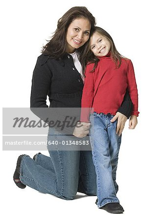 Portrait of a mother hugging her daughter Stock Photo - Premium Royalty-Free, Image code: 640-01348583