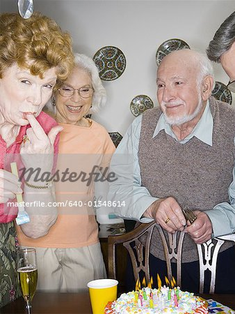 Seniors at a birthday party Stock Photo - Premium Royalty-Free, Image code: 640-01348614