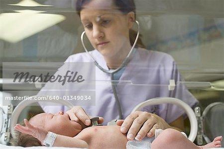 Nurse Holding Newborn Baby