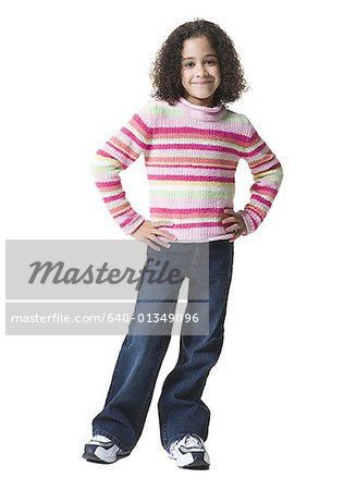 Portrait of a girl smiling and standing Stock Photo - Premium Royalty-Free, Image code: 640-01349096
