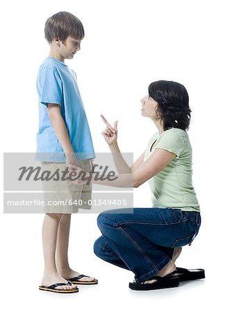 Close-up of a mid adult woman scolding her son Stock Photo - Premium Royalty-Free, Image code: 640-01349405