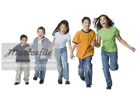 Group of children holding hands and running Stock Photo - Premium Royalty-Free, Image code: 640-01350411