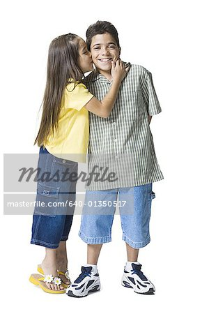 Profile of a sister kissing her brother Stock Photo - Premium Royalty-Free, Image code: 640-01350517