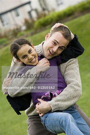 Portrait of a father hugging his daughter Stock Photo - Premium Royalty-Free, Image code: 640-01350562